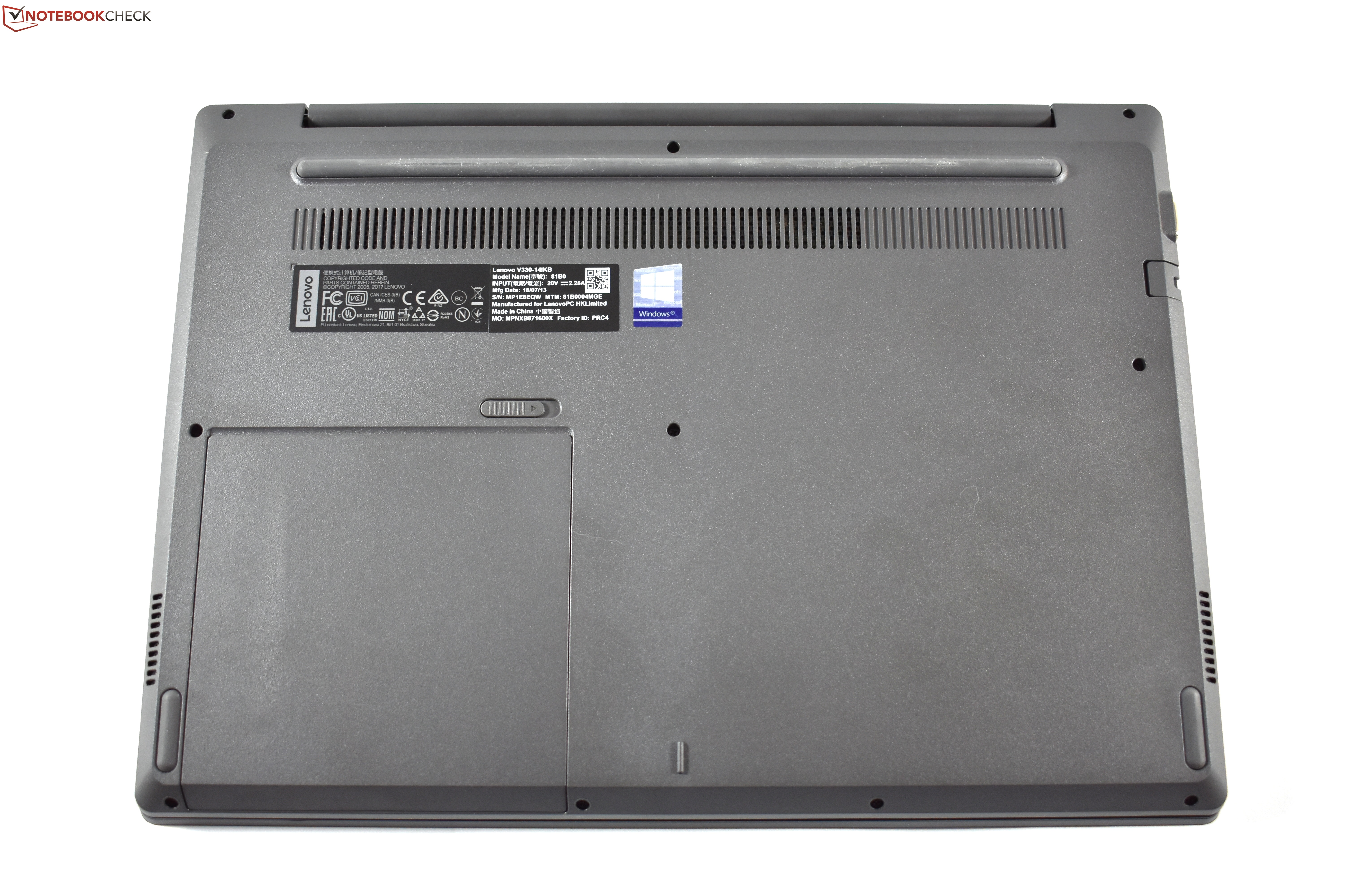 where is the serial number on lenovo laptop