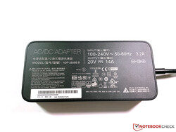 The 280W power adapter tips the scale at almost 1 kg.