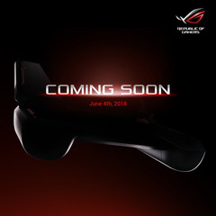 An image showing what appears to be a possible gaming phone attached to a physical controller. (Source: Asus ROG)