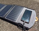 We tried charging our smartphone with a 22 W foldable solar power charger. It took days