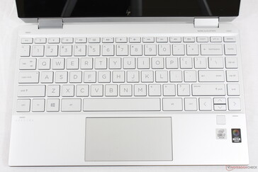 The gray font doesn't contrast very well against the silver key caps and palm rests
