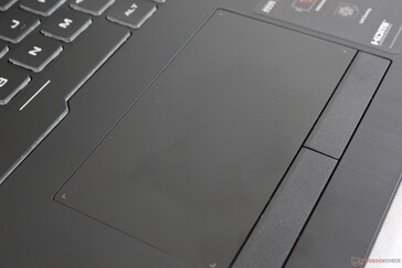 Touchpad surface is completely smooth with no bumpy texture. Still, it's quite small for a large 17.3-inch display