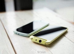Oppo N1 mini smartphone with rotating camera and gold frame