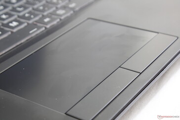 Center of trackpad doubles as a fingerprint reader. Its ultra-smooth surface, however, is very different from most other laptops