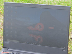The ThinkPad outdoors (under a cloudy sky).