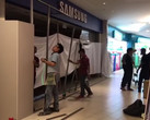 A fire erupted at a Samsung Experience Store in Singapore; workers cordoned off the shop after it was put out. (Source: The Straits Time)