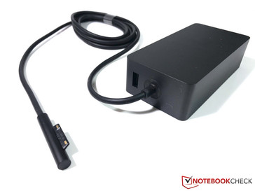 The 102 W power adapter with an additional USB port
