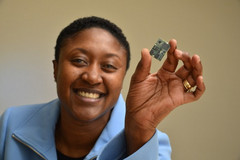 Exec of Intel's Communication and Devices division, Aicha Evans, holds up a modem. (Source: The Motley Fool)