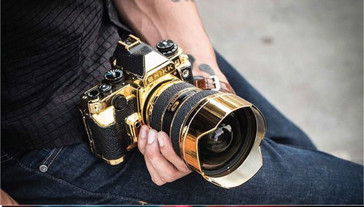 Gold and leather-adorned Nikon kit. (Source: Brikk)