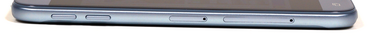 Left: Volume controls, micro-SD slot, SIM slot