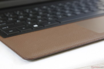 Leather palm rests are more resistant to fingerprints than the typical glossy metal surface