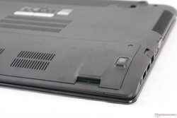 A fully inserted SD card sits flush against the chassis, but access is made difficult