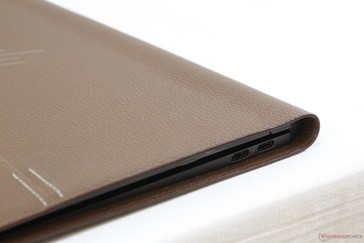 Leather casing extends beyond the edges of the metal chassis and adds to the footprint