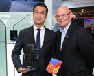 A Huawei representative accepts the award from John Hoffman, the CEO of GSMA. (Source: Huawei)