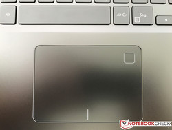 Touchpad with integrated fingerprint scanner