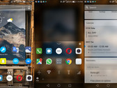 Arrow Launcher running on one of our handsets, showing a homescreen with rotating wallpaper (left), extra options when swipping up on the bottom row shortcuts (middle), and the quick cards screen (right). (Source: Own)