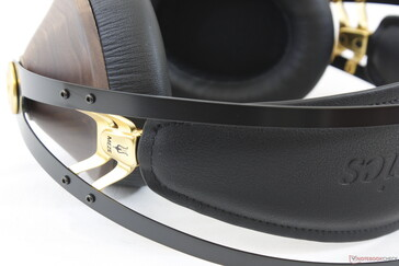 The inner faux-leather headband will automatically adjust up or down and can be removed with a Philips screwdriver if needed