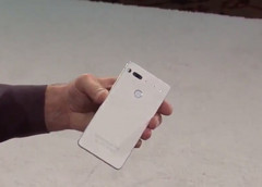 Andy Rubin holds a white version of his Essential phone. (Source: Twitter)