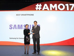 "Samsung representative receives the ""Best Smartphone"" award at AMO 17 for the Galaxy S8 flagship"