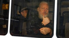Julian Assange after being arrested by the London Metropolitan Police (Image source: Reuters)