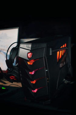 MSI Aegis 3 8RD with its headset holders and RGB lighting switched on (Source: MSI)