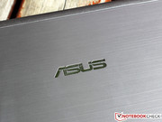 Asus logo on polished aluminum: