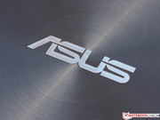 The Asus logo in brushed aluminum: