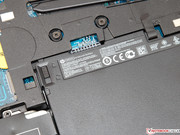 The 50 Wh battery can be removed easily. It is not glued or fastened with screws.