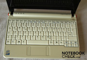 The keyboard is also white, some keys are very small, but the layout is standard.