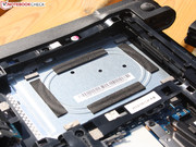 The 2.5-inch HDD is not secured by screws, but sits in a buffered cage.