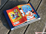 The 13.3 inch laptop doesn't fit in the jacket pocket like this Ducktales paperback,