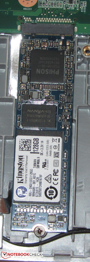 An SSD in M.2 format is the system drive. You have to remove the battery in order to reach it.