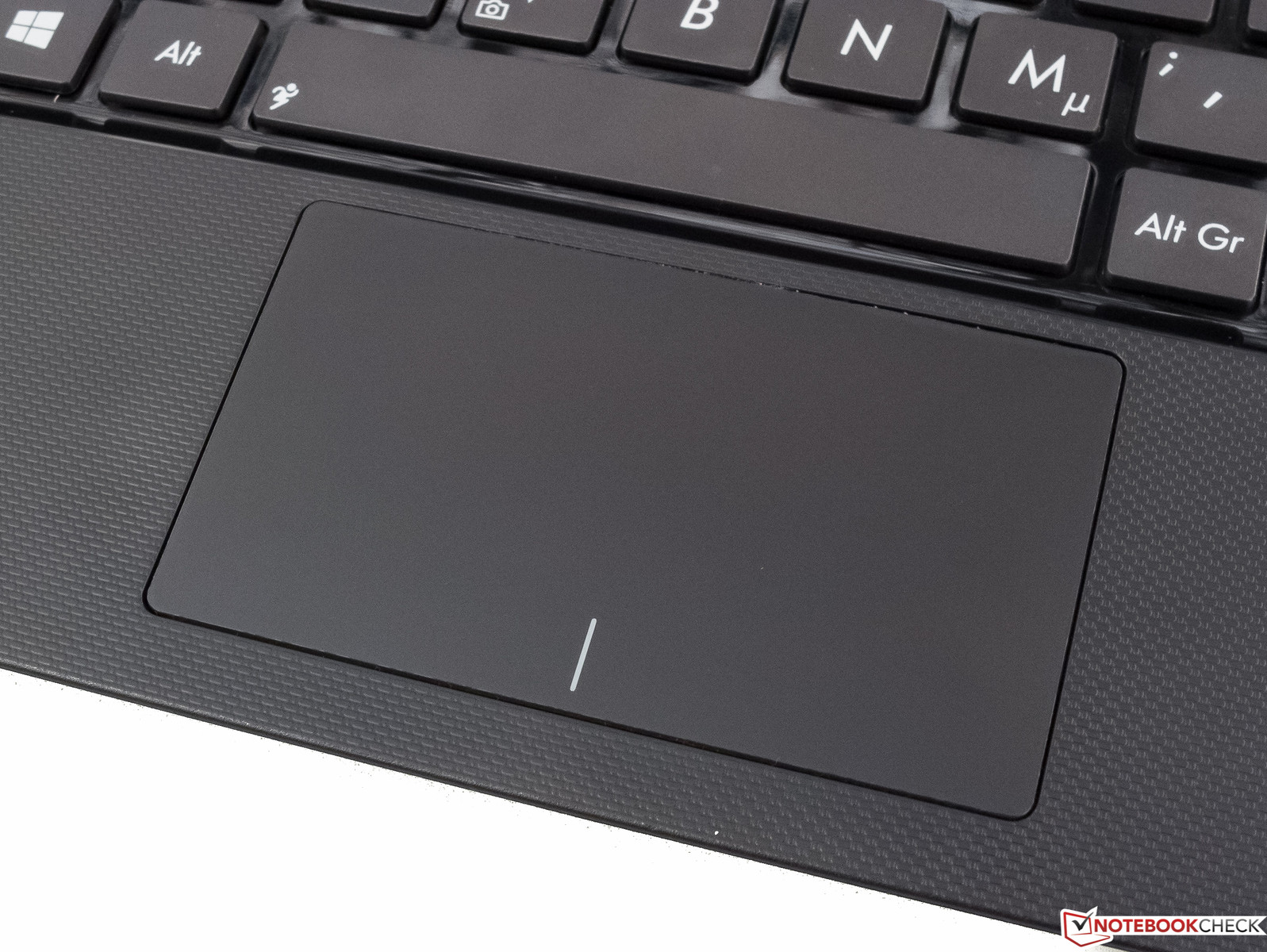 The touchpad is sleek and too small. The latter can barely be avoided.