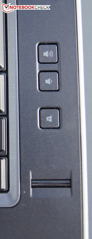 A fingerprint scanner is on the keyboard's right and volume control is beside the speakers.