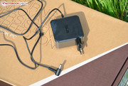 The power adapter offers 65 W.