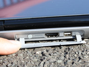 HDMI and a mini DisplayPort are underneath the rubber cover (rear).