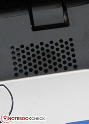 The speakers are located above the keyboard.