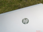 The striking HP logo on the back is implemented in piano paint.