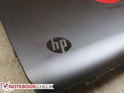 The glossy and humble HP logo is contrasting to the matte notebook