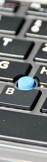 "Toshiba's TrackPoint is called ""Accupoint""."