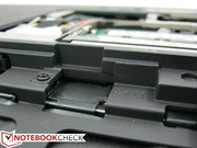 SIM card slot located beneath the battery compartment