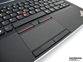 The touchpad is surrounded by four mouse keys