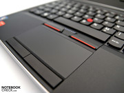 The big touchpad is surrounded by four mouse keys.