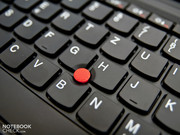 Lenovo's mandatory TrackPoint gleams in bright red and is between the keys.