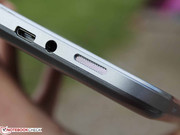The speakers and few interfaces are distributed on the device's lower and right edge..