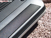 The speakers are on the front behind the perforated grille.