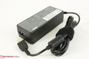 Small AC adapter outputs 20 V