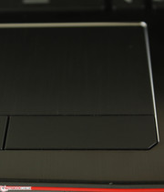 Brushed aluminum touchpad with chrome perimeter