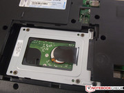 The hard disk is screwed to a frame that is screwed to the case.