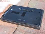 The underside of the laptop is dominated by a large maintenance hatch,
